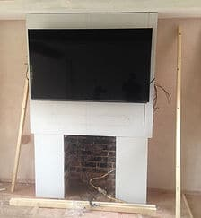 wall mounted tv in progress , above open fireplace