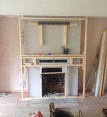 installation process of wall mounting tv, wooden frame in place