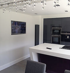 wall mounted tv in kitchen area