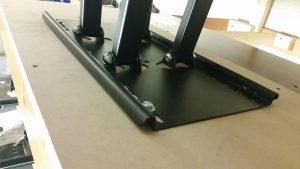wall mounting tv in progress. black bracket