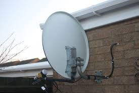 satellite dish installation on brick wall