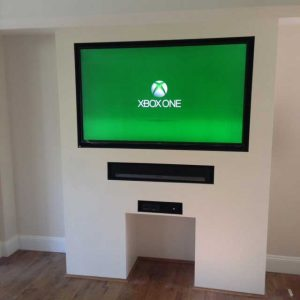 wall mounted tv on white wall, xbox one on screen